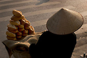 A woman sells bread in the French Quarter in Hanoi, Vietnam.