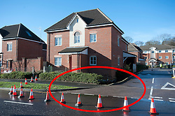 **Red circle indicates the location of the sinkhole** © London News Pictures. 15/02/2014. Hemel Hempstead, UK.  A giant sinkhole measuring 35ft wide by 20ft deep has opened up next to a house in Hemel Hempstead, Hertfordshire.   Photo credit: Ben Cawthra/LNP