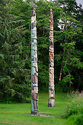 On the left is the Sea Monster Pole (pole 9), on the right is the Master Carver Pole (pole8), Totem Bight State Historical Park, Ketchikan, Alaska