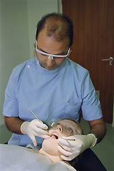 Dental examination or check up; with dentist wearing protective eyewear,