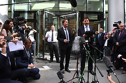 Sir Cliff Richard (centre) with his lawyer, Gideon Benaim, outside the Rolls Building in London where he was awarded more than £200,000 in damages after winning his High Court privacy battle against the BBC over its coverage of a police search of his home in Sunningdale, Berkshire, in August 2014, following a child sex assault allegation.