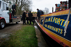 Funeral procession for boatman John Forth makes its way through the locks on the Grand Union Canal in Long Itchington, near Southam, Warwickshire, England, UK.