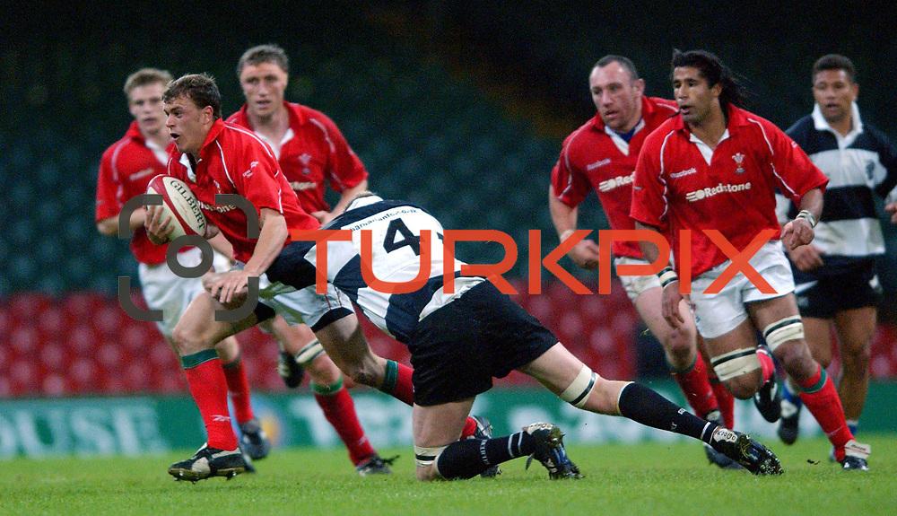 l-r; Wales' Craig Morgan is tackled by Barbarians' Doddie Weir