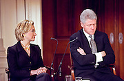 President and Mrs. Clinton attend the Millennium evening lecture on 'Women as Citizens' in the East Room of the White House March 15, 1999. The Clinton's appeared together for the first time since rumors of marital separation.