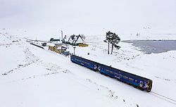 Corrour, Scotland, UK. 28 January, 2020.  A Scotrail train travels through heavy snow at Corrour Station on it's way from Glasgow to Mallaig on the West Highland Line. Corrour Station is the highest railway in Britain at a height of 1338 feet above sea level. Iain Masterton/Alamy Live News.