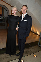 DAPHNE GUINNESS and NICK KNIGHT at a private view of Isabella Blow: Fashion Galore! held at Somerset House, London on 19th November 2013.