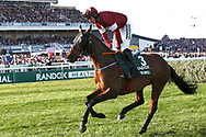 Tiger Roll and Davey Russell hed down to the start of the 5:15pm The Randox Health Grand National Steeple Chase (Grade 3) 4m 2f during the Grand National Meeting at Aintree, Liverpool, United Kingdom on 6 April 2019.