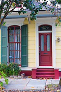 Traditional bright colour clapboard creole cottage home in Faubourg Marigny historic district  of New Orleans, USA