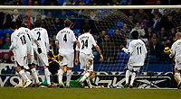 Photo: Jed Wee.<br />Bolton Wanderers v Wigan Athletic. The FA Barclaycard Premiership. 04/02/2006.<br />Bolton players watch rooted to the spot as Wigan's Andreas Johansson reacts first to a spill from Bolton goalkeeper Jussi Jaaskelainen to score the equaliser.