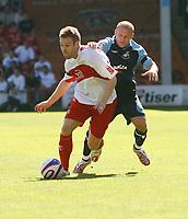 Photo: Steve Bond.<br /> Walsall v Swansea City. Coca Cola League 1. 25/08/2007. Andy Robinson (R) harries Rhys Weston (L)