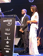 Kanye West and Naomi Campbell..2011 amfAR's Cinema Against AIDS Gala Inside..2011 Cannes Film Festival..Hotel Du Cap..Cap D'Antibes, France..Thursday, May 19, 2011..Photo By CelebrityVibe.com..To license this image please call (212) 410 5354; or.Email: CelebrityVibe@gmail.com ;.website: www.CelebrityVibe.com.**EXCLUSIVE**