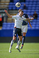 Gary Madine (Bolton Wanderers) wins the header despite a hand on his shoulder during the Pre-Season Friendly match between Bolton Wanderers and Preston North End at the Macron Stadium, Bolton, England on 30 July 2016. Photo by Mark P Doherty.