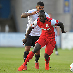 TELFORD COPYRIGHT MIKE SHERIDAN Cliff Moyo holds off Ellis Deeney of Telford during the National League North fixture between AFC Telford United and Kidderminster Harriers on Tuesday, August 6, 2019.<br /> <br /> Picture credit: Mike Sheridan<br /> <br /> MS201920-006