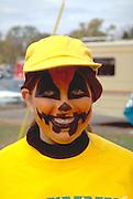 Girl age 14 in pumpkin costume at Anoka Halloween Festival Parade.  Anoka Minnesota USA
