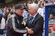 Tony Pulis, the West Bromwich Albion manager and Alan Pardew, the Crystal Palace manager (r) talk before k/o. Barclays Premier League match, Crystal Palace v West Bromwich Albion at Selhurst Park in London on Saturday 3rd October 2015.<br /> pic by John Patrick Fletcher, Andrew Orchard sports photography.