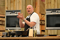 © Licensed to London News Pictures. 05/05/2014; Bristol, UK.  Tom Kerridge does a live demonstration of cooking lamb shank with bay and borlotti beans, and buttered ham with English asparagus and parsley, at the Bristol Food Connections festival in the Harbourside area of the city.<br /> Photo credit: Simon Chapman/LNP