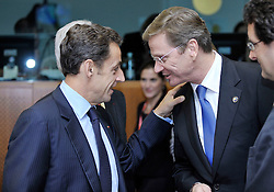 """Nicolas Sarkozy, France's president, left, speaks with Guido Westerwelle, Germany's new foreign minister, during the European Union Summit at the EU headquarters in Brussels, Belgium, on Thursday, Oct. 29, 2009. European Union leaders are set for """"very difficult"""" talks to overcome the Czech Republic's resistance to a new governing treaty designed to strengthen the EU's influence in world affairs, Reinfeldt said. (Photo © Jock Fistick)"""