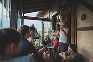 Mincho, who founded Albergue Verde, talks with his guests after another delicious home-cooked dinner in Hospital de Órbigo, Spain. (June 27, 2018)<br />