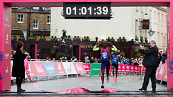 Mo Farah celebrates as he comes in to win the Vitality Big Half in London City Centre.