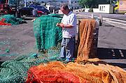 Fisherman mending nets, Castletownbere, County Cork, Ireland