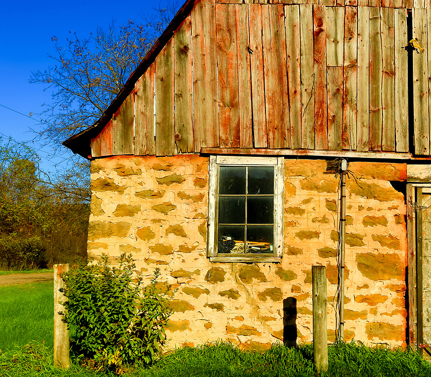 Old barn in bright autumn sun on a fall afternoon in Wisconsin's Baraboo Range. Photo taken October 28, 2019.