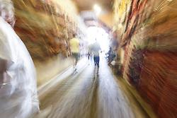 Peiople walking through alleys, Fes al Bali medina, Fes, Morocco