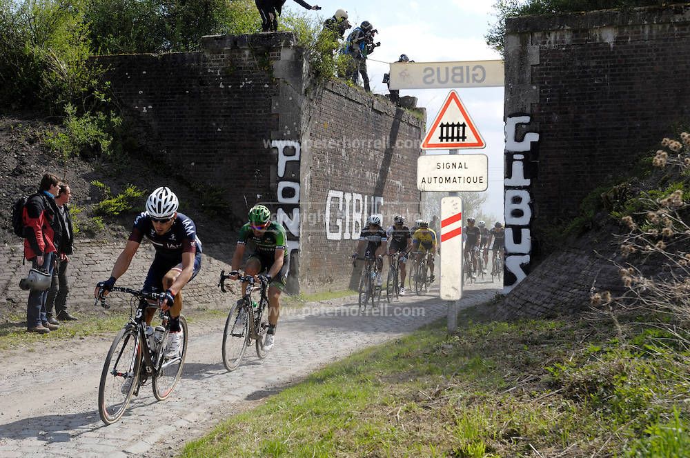 France, April 13th 2014: The main chasers pass through Pont Gibus, Wallers, in pursuit of the break during the 2014 edition of Paris Roubaix.