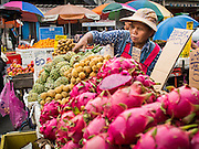 06 AUGUST 2014 - BANGKOK, THAILAND:  A woman selling fruit in a market in the Chinatown section of Bangkok.    PHOTO BY JACK KURTZ