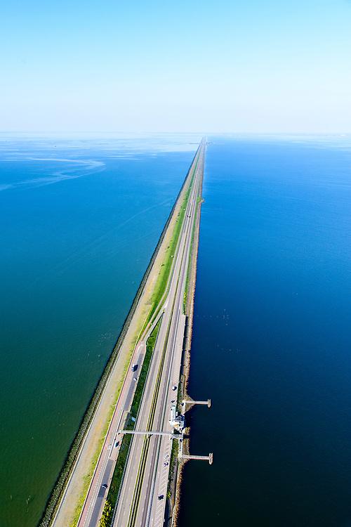 Nederland, Noord-Holland, Den Oever, 07-05-2018; Afsluitdijk met Vlietermonument. Het Monument is verrezen op de plaats - de Vlieter - waar het laatste gat in de Afsluitdijk in 1932 gesloten werd. Friesland aan de verre horizon. Waddenzee links in beeld.<br /> Enclosure Dam with Monument. Waddenzee (left), Friesland on the distant horizon.<br /> <br /> luchtfoto (toeslag op standard tarieven);<br /> aerial photo (additional fee required);<br /> copyright foto/photo Siebe Swart