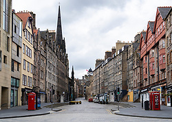 Edinburgh, Scotland, UK. 29 April 2020. Views of Edinburgh Old Town as coronavirus lockdown continues in Scotland. Streets remain deserted and shops and restaurants closed and many boarded up. Scottish Government now recommends public to wear face masks. A deserted Royal Mile at Lawnmarket. . Iain Masterton/Alamy Live News
