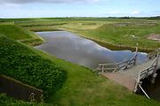 Texel is het grootste Nederlandse Waddeneiland. Het landschap op Texel is rijk en divers. Texel heeft behalve polders, brede zandstranden, duinen en graslanden ook heide, bos en kwelders. <br /> <br /> Texel is the biggest Dutch Wadden Island. The landscape on the island is rich and diverse. Texel has besides polders, wide sandy beaches, dunes and grasslands also heaths, woods and marshes.<br /> <br /> Op de foto / On the photo:  Fort de Schans is een fort in Oudeschild op Texel. / Fort de Schans is a fortress in Oudeschild on Texel.
