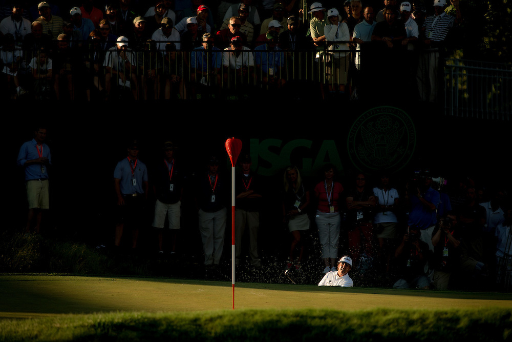 Phil Mickelson plays out of a bunker during the2013 U.S. Open at Merion Golf Club in Ardmore, Pennsylvania.