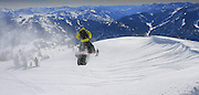 Tim Hoff carries speed off the lip of a cornice in the Snake River range, facing southeast into the northern portion of the Wyoming range.