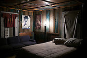 Bedroom in cabin at The Shack Up Inn a cotton pickers themed hotel in Clarksdale, birthplace of the Blues, Mississippi, USA
