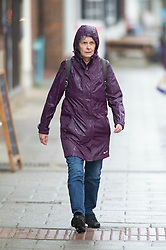 © Licensed to London News Pictures 18/05/2021.  Sevenoaks, UK. A woman looking very wet in Sevenoaks High Street in Kent this afternoon. The wet weather continues today in Kent with little sign of letting up. Photo credit:Grant Falvey/LNP