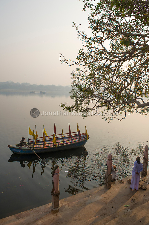 High angle view of a boat, tree and temple on the Yamuna river, India.