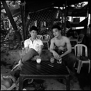 Two friends relax and enjoy an iced vietnamese coffee. Danang, Vietnam, Asia
