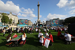 © Licensed to London News Pictures. 07/07/2021. London, UK. England fans gather at the Fan Zone in Trafalgar Square, central London, for the Euro 2020 semi final between England and Denmark. England are attempting to reach their first final since 1966. Photo credit: Ben Cawthra/LNP