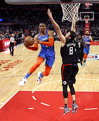 March 8, 2019 - Los Angeles, California, U.S - Oklahoma City Thunder's Russell Westbrook (0) goes to basket while defended by Los Angeles Clippers' Danilo Gallinari (8) during an NBA basketball game between Los Angeles Clippers and Oklahoma City Thunder Friday, March 8, 2019, in Los Angeles. (Credit Image: © Ringo Chiu/ZUMA Wire)