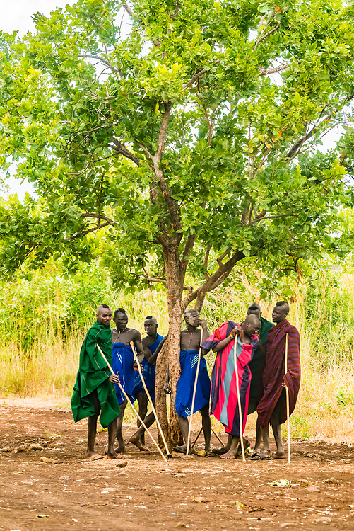 Mursi tribe boys and men, Mago National Park, Omo Valley, Ethiopia.