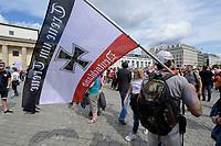 """29 AUG 2020, BERLIN/GERMANY:<br /> Mann mit Alu-Pickelhaube und Flagge Schwarz-Weiß-Rot der Flagge des Norddeutschen Bundes und des Deutschen Reichs, mit eisernem Kreuz, Demonstration gegen die Einschraenkungen in der Corona-Pandemie durch die Initiative """"Querdenken 711"""" aus Stuttgart unter dem Motto """"invites Europa - Fest für Freiheit und Frieden"""", Unter den Linden/Pariser Plastz/Friedrichstrasse<br /> IMAGE: 20200829-01-049<br /> KEYWORDS: Demo, Protest, Demosntranten, Protester, COVID-19, Corona-Demo"""
