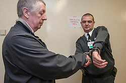 Defendant being taken down to the cells by security staff