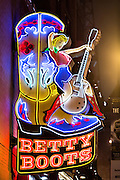 Neon sign for Betty Boots and other honky-tonks on lower Broadway in Nashville, TN.