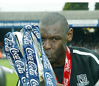 Photo: Chris Ratcliffe.<br />Southend United v Bristol City. Coca Cola League 1. 06/05/2006.<br />Shaun Goater of Southend United sheds a tear as he celebrates with the trophy at the end of his last professional game ever.