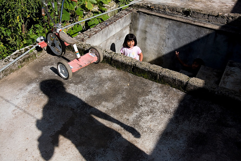 A young girl appears in an outdoor stairwell in Santa Martha Latuvi, part of the Pueblos Mancomunados, a network Zapotec villages in the Sierra Norte Mountains of Oaxaca state, Mexico.