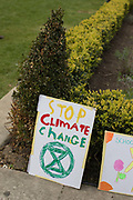 Stop climate change placard at Parliament Square on the 12th April 2019 in London in the United Kingdom.
