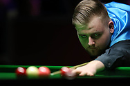 Jackson Page, the 16 year old amateur from South Wales during his 1st round match against Sean O'Sullivan. ManBetx Welsh Open Snooker 2018, day 1 at the Motorpoint Arena in Cardiff, South Wales on Monday 26th February 2018.<br /> pic by Andrew Orchard, Andrew Orchard sports photography.