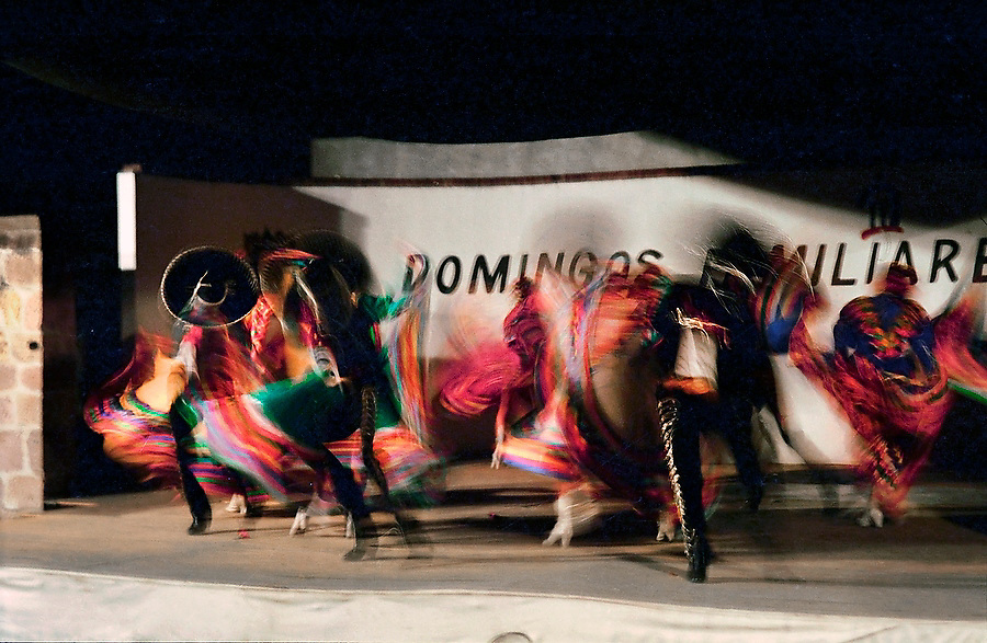 Dancers in traditional costumes swirl during a folk dancing performance in Morelia, Michoacan, Mexico.