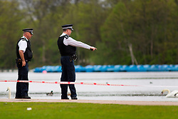 © licensed to London News Pictures. London, UK 07/04/2014. Police officers searching  the Serpentine in Hyde Park after a man in his 20s  feared drowned after taking a dip on Sunday afternoon of April 6, 2014. The lake has been cordoned off as the search continues on Monday, April 7, 2014. Photo credit: Tolga Akmen/LNP