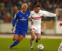 Photo: Scott Heavey.<br /> VFB Stuttgart v Chelsea. Champions League Quarter Final First Leg. 25/02/2004.<br /> Eidur Gudjohnsen battles with Horst Heldt